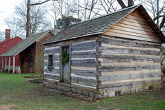 Antebellum Cabin. An antebellum log cabin and brick out building Stock Images