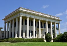 Antebellum Georgia Mansion. This is a Summer picture of the Cowles-Woodruff Mansion located on the campus of Mer era University in Macon, Goegia on Bibb County royalty free stock photo