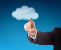 Antebrazo que señala en el icono de la nube con el espacio de la copia Foto de archivo