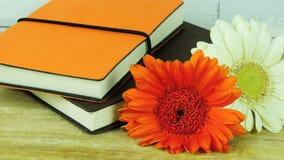 Anteckningsböcker med blommor royaltyfri foto