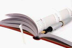 anteckningsbok öppnad penna Royaltyfri Fotografi