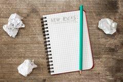 Anteckningsbok för nya idéer Arkivfoton