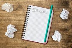 Anteckningsbok för nytt plan Arkivfoton