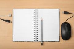 Anteckningsbok med blyertspenna- och datorutrustning Royaltyfria Bilder
