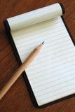 Anteckningsbok med blyertspennan Royaltyfri Bild