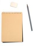 Anteckningsbok med blyertspennan och radergummit Royaltyfri Bild