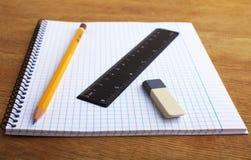 Anteckningsbok med blyertspennan och radergummit Royaltyfria Foton