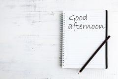 Anteckningsbok med blyertspennan på den wood smeteftermiddagen Arkivfoto