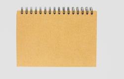 Anteckningsbok med brunt Royaltyfri Foto