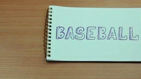 Anteckningsbok med en inskriftbaseball arkivfilmer