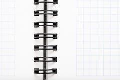 Anteckningsbok med svart tråd Arkivbild