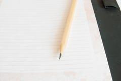 Anteckningsbok och blyertspenna Royaltyfri Foto