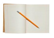 Anteckningsbok och blyertspenna Fotografering för Bildbyråer