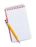 Anteckningsbok och blyertspenna Arkivfoto