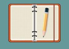 Anteckningsbok och blyertspenna som isoleras på en bakgrund Royaltyfri Bild