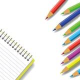 Anteckningsbok och blyertspennor Arkivbild