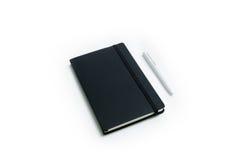 Anteckningsbok- och vitpenna fotografering för bildbyråer