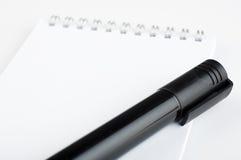 anteckningsbokblyertspenna arkivfoto