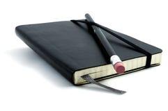 anteckningsbokblyertspennaöverkant Royaltyfria Bilder