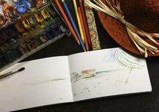 Anteckningsboken med ritar Arkivbilder
