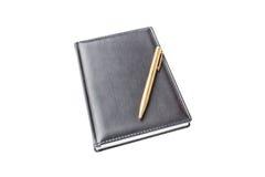 Anteckningsboken med skrivar arkivfoton