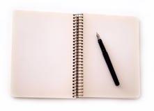 Anteckningsboken och skrivar Royaltyfri Bild