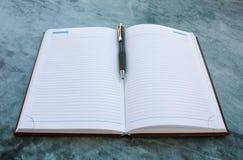 Anteckningsboken och skrivar Royaltyfri Fotografi
