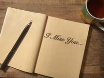 Anteckningsboken, som är mig, missa You som är skriftlig på den Arkivfoton