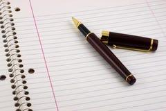 anteckningsbokpenna Fotografering för Bildbyråer