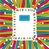 Anteckningsbokram av färgrika blyertspennor Royaltyfria Bilder