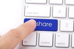 Anteilwort auf Tastatur Stockfotografie