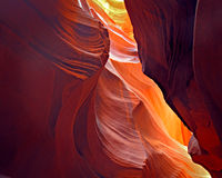 Antelope Canyon Abstract 1. Red, Orange and Yellow reflected sunlight on curved and layered slot canyon wall stock images