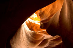 Antelope Canyon Shadows. Antelope Canyon canyon curves. Sunlight shining through the curved canyon walls of Antelope Canyon. Plenty of room for copy in the Royalty Free Stock Image