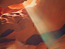 Antelope Canyon Sunbeam 1. Diagonal sun beam in red rock slot canyon royalty free stock photography
