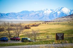 An entrance road going to Antelope Island State Park, Utah stock image