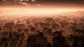 Antena de la ciudad remota del desierto en la puesta del sol en la niebla Fotos de archivo libres de regalías