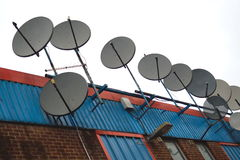 Antenas de satélite Imágenes de archivo libres de regalías