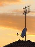 Antenas en la puesta del sol Fotografía de archivo libre de regalías