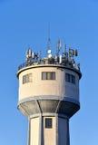 Antenas en torre de agua Foto de archivo libre de regalías