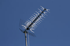 Antenna. Standing on top of the roof Royalty Free Stock Image