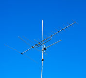 Antenna. Home advance TV antenna on blue sky stock photo