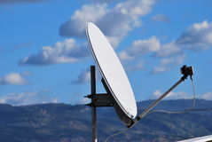 Antenna. A parabolic antenna against the sky Royalty Free Stock Photo
