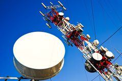 Antenna. Big red and white antenna with blue sky Royalty Free Stock Photo