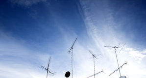 Antenna. S,TV  on the roof of a building, under the blue sky,An ordinary aerial television , mostly made of aluminum materials against the blue sky,Home advance Royalty Free Stock Photo