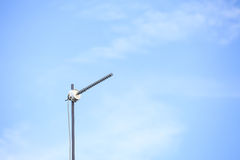 An antenna. Over blue sky Royalty Free Stock Photo