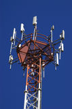 Antenna. Tower with parabolic antennas and used for the transmission of communications Stock Photos
