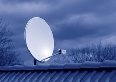Antenna. A antenna on a roof in blue Royalty Free Stock Photos