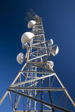 Antenna. Repeater of communication in blue sky Stock Images