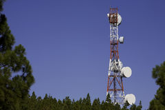 Antenna. Telecommunications tower for broadcasting on perfect blue sky Stock Images