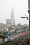 Antenna above the old town in mist Royalty Free Stock Images